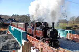 Merddin Emrys_AT2-3-11first train across bypass bridge Minffordd.jpg (93752 bytes)