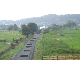 S12_JE7-8-08WHRP train and Traeth Mawr from OB217.jpg (37830 bytes)